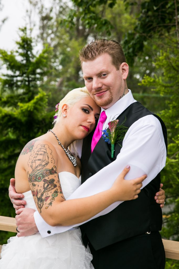 Bride and groom hugging at Riviera Waterfront Mansion wedding