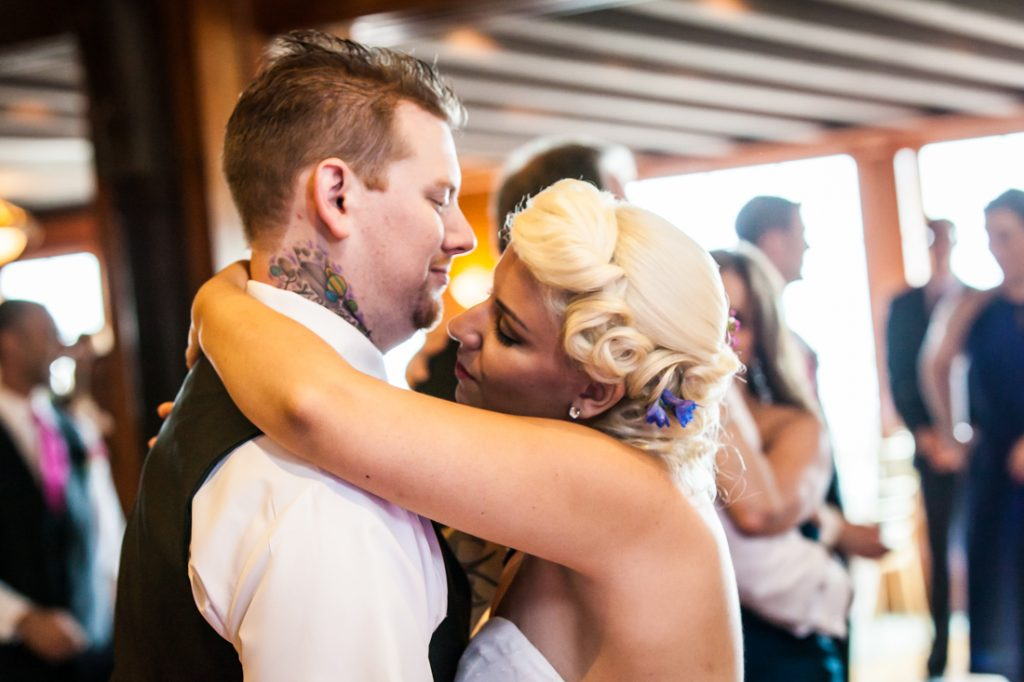 Bride and groom during first dance at Riviera Waterfront Mansion wedding