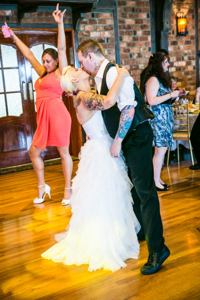Bride and groom kissing on dance floor at Riviera Waterfront Mansion wedding