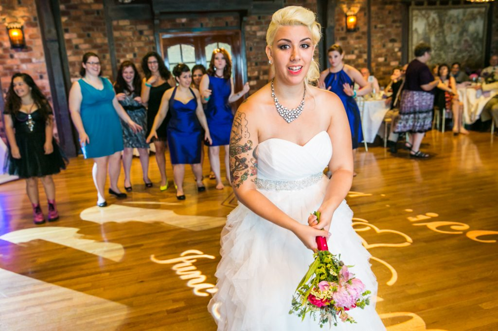 Bride about to throw bouquet at Riviera Waterfront Mansion wedding