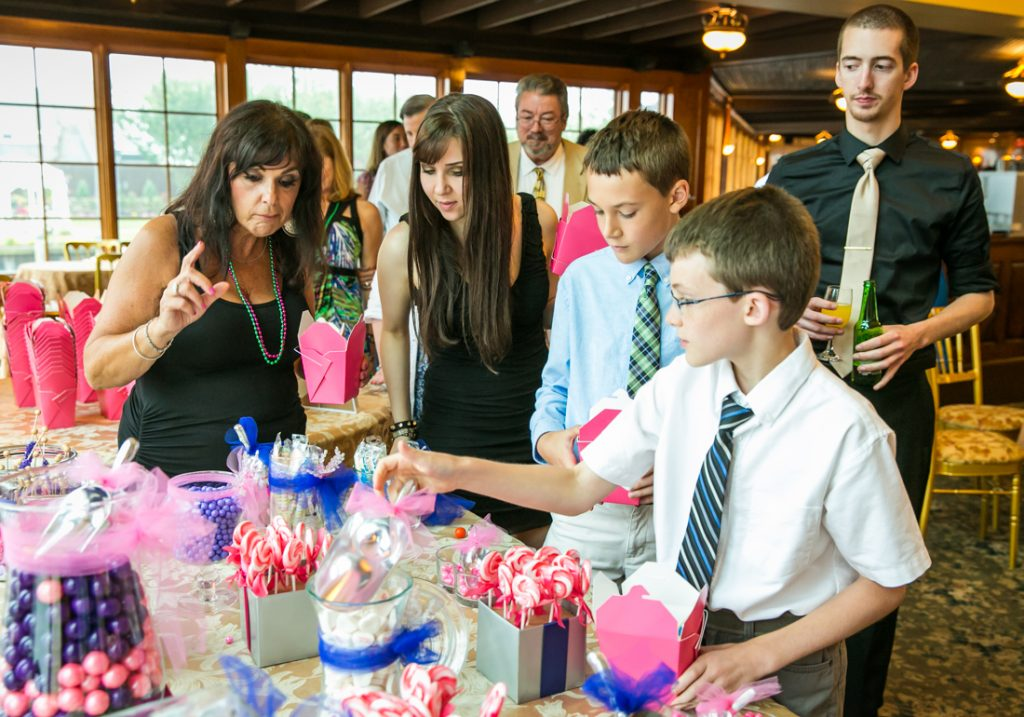 Guests at candy buffet at Riviera Waterfront Mansion wedding