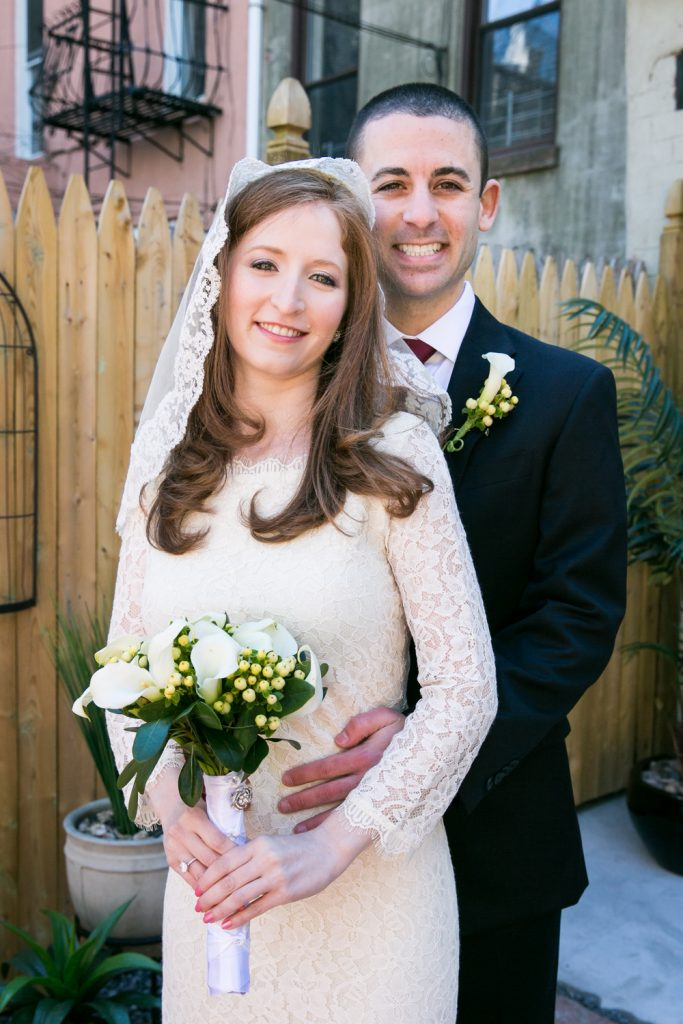Portrait of bride and groom at Brooklyn backyard wedding ceremony