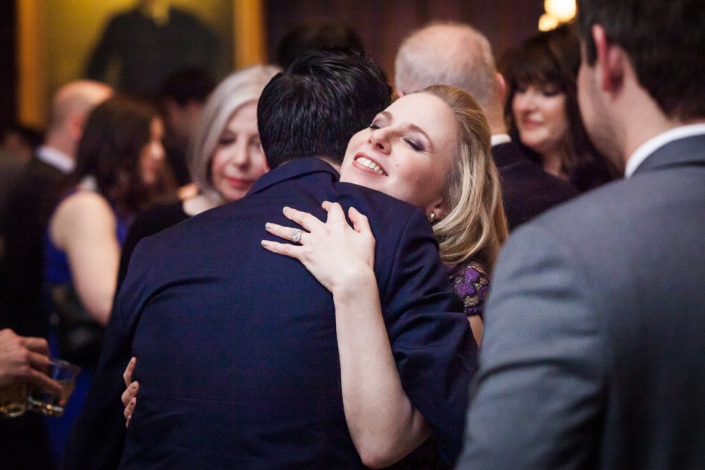 Harvard Club wedding photos of woman hugging guest
