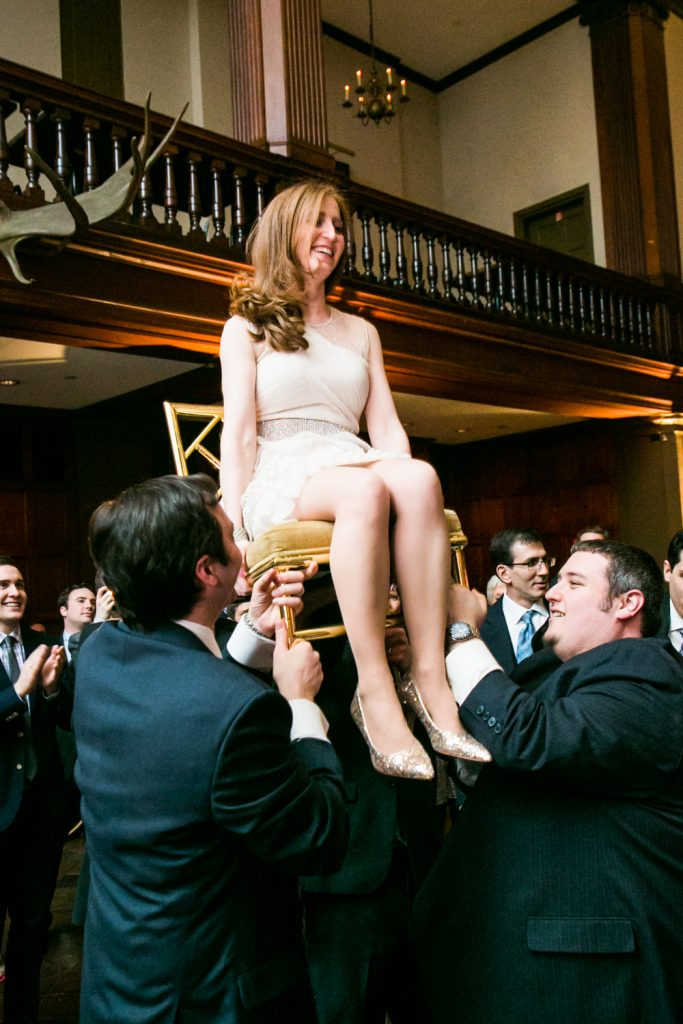 Harvard Club wedding photos of bride lifted up during hora dance
