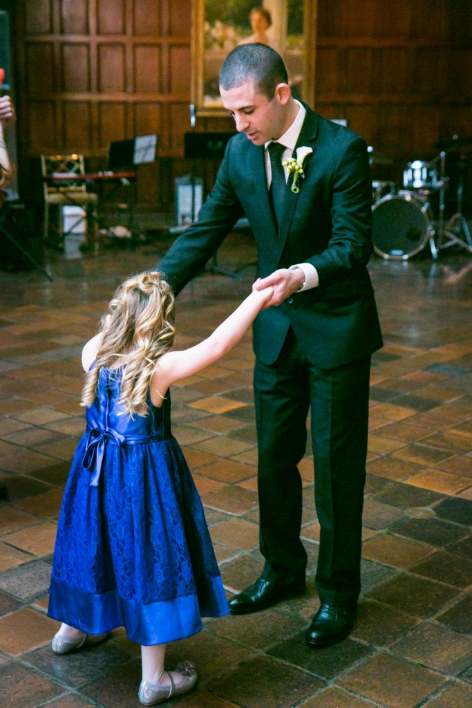 Harvard Club wedding photos of groom dancing with little girl