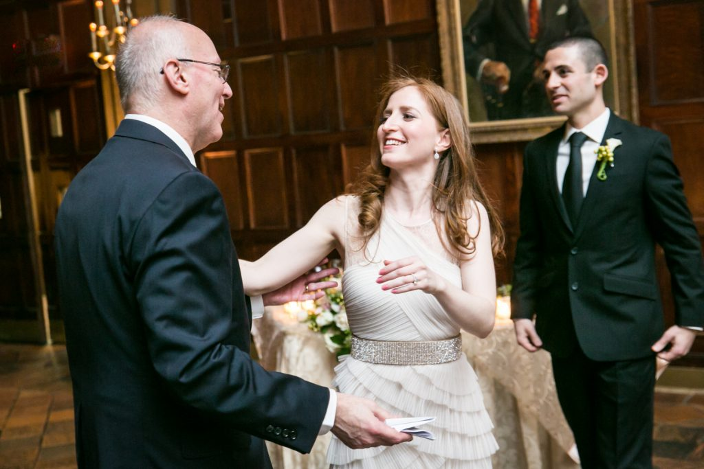 Harvard Club wedding photos of bride and groom greeting father