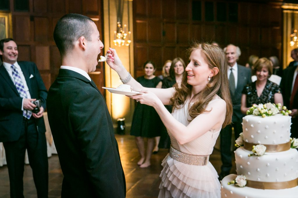 Harvard Club wedding photos of bride feeding cake to groom