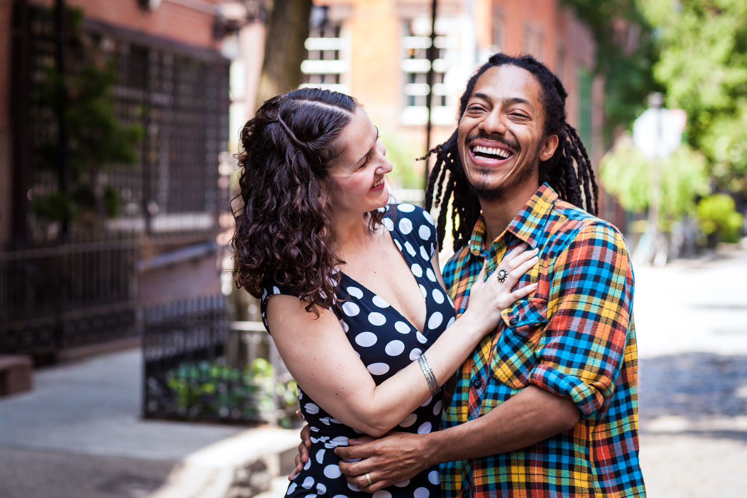Meatpacking District engagement photos of couple laughing on a Greenwich Village street
