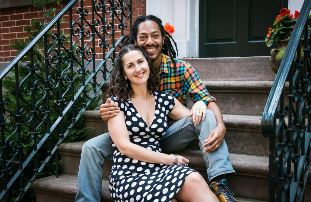Meatpacking District engagement photos of couple sitting on apartment steps