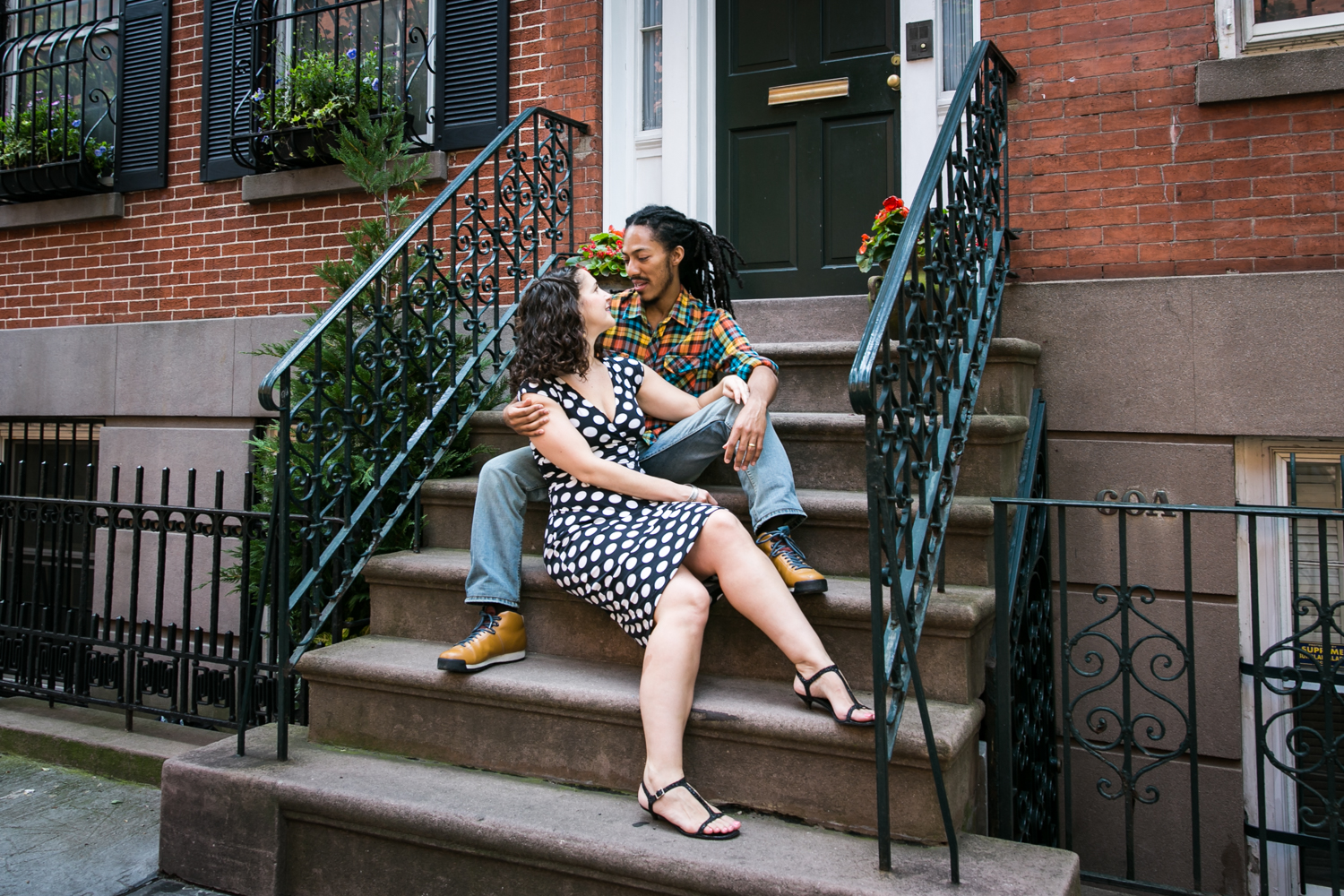 Meatpacking District engagement photos of couple sitting on brownstone steps