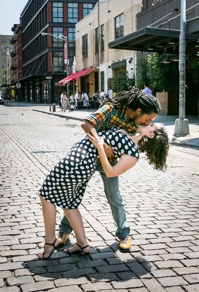 Meatpacking District engagement photos of couple dancing in middle of street