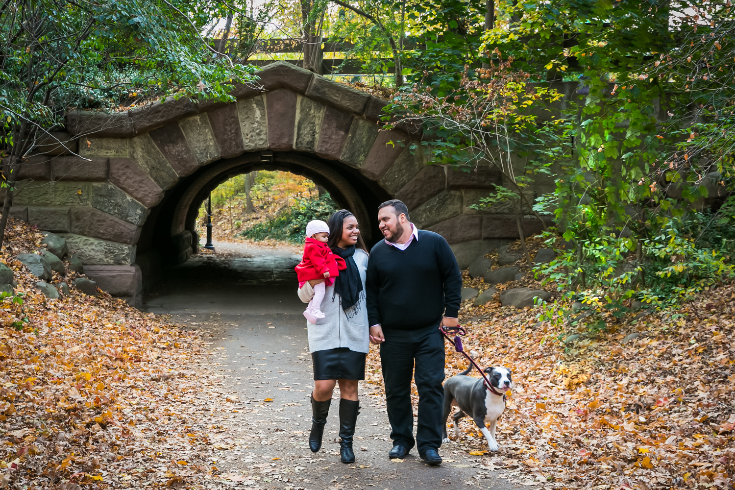 Prospect Park family portrait of family walking in front of arch in park