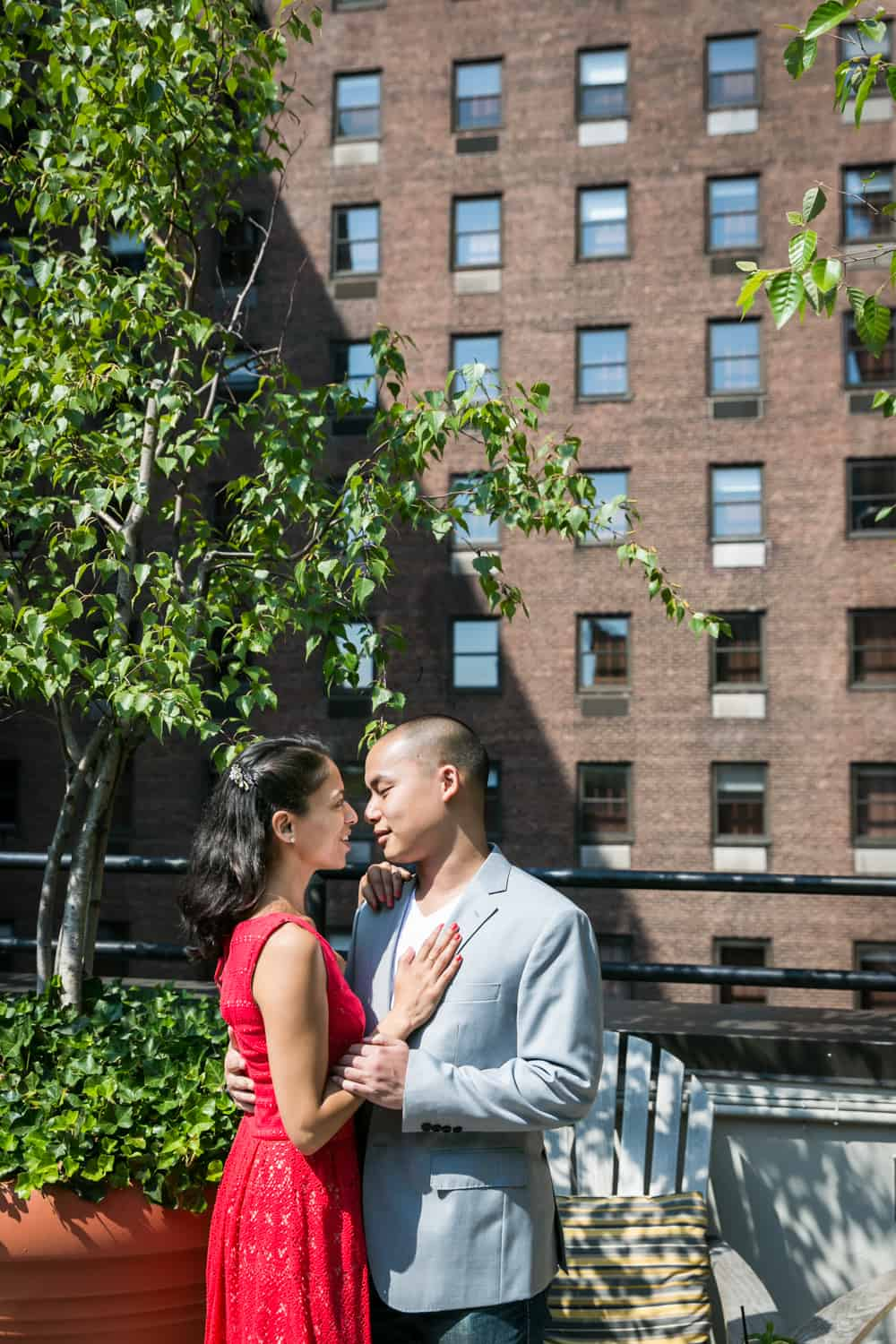 Couple on roof of hotel during a Hudson Hotel engagement shoot