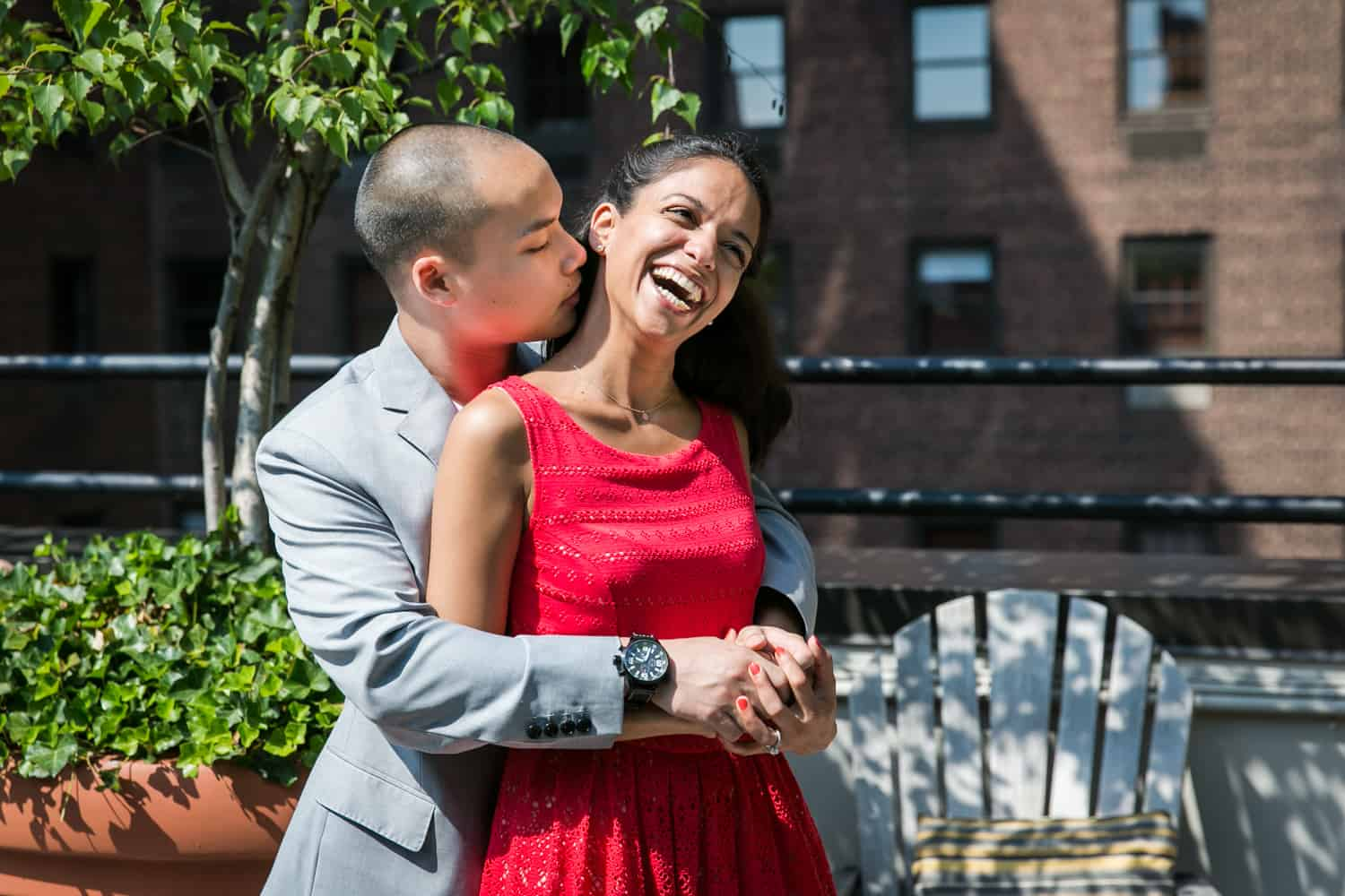 Couple hugging on roof terrace during a Hudson Hotel engagement shoot