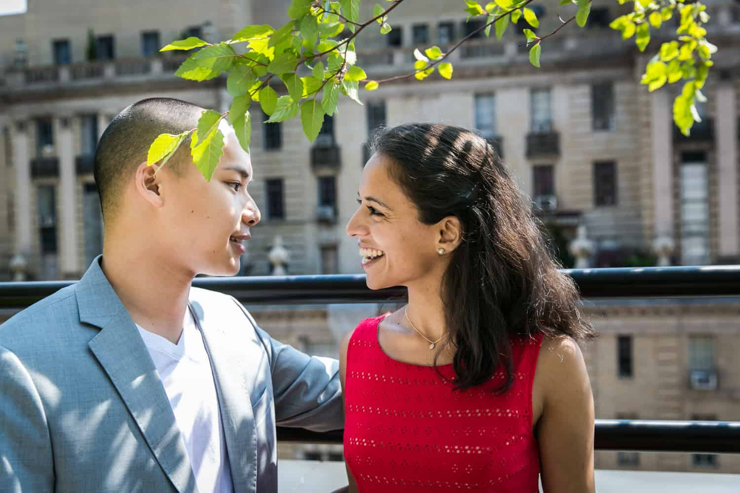 Couple under branches on roof terrace during a Hudson Hotel engagement shoot