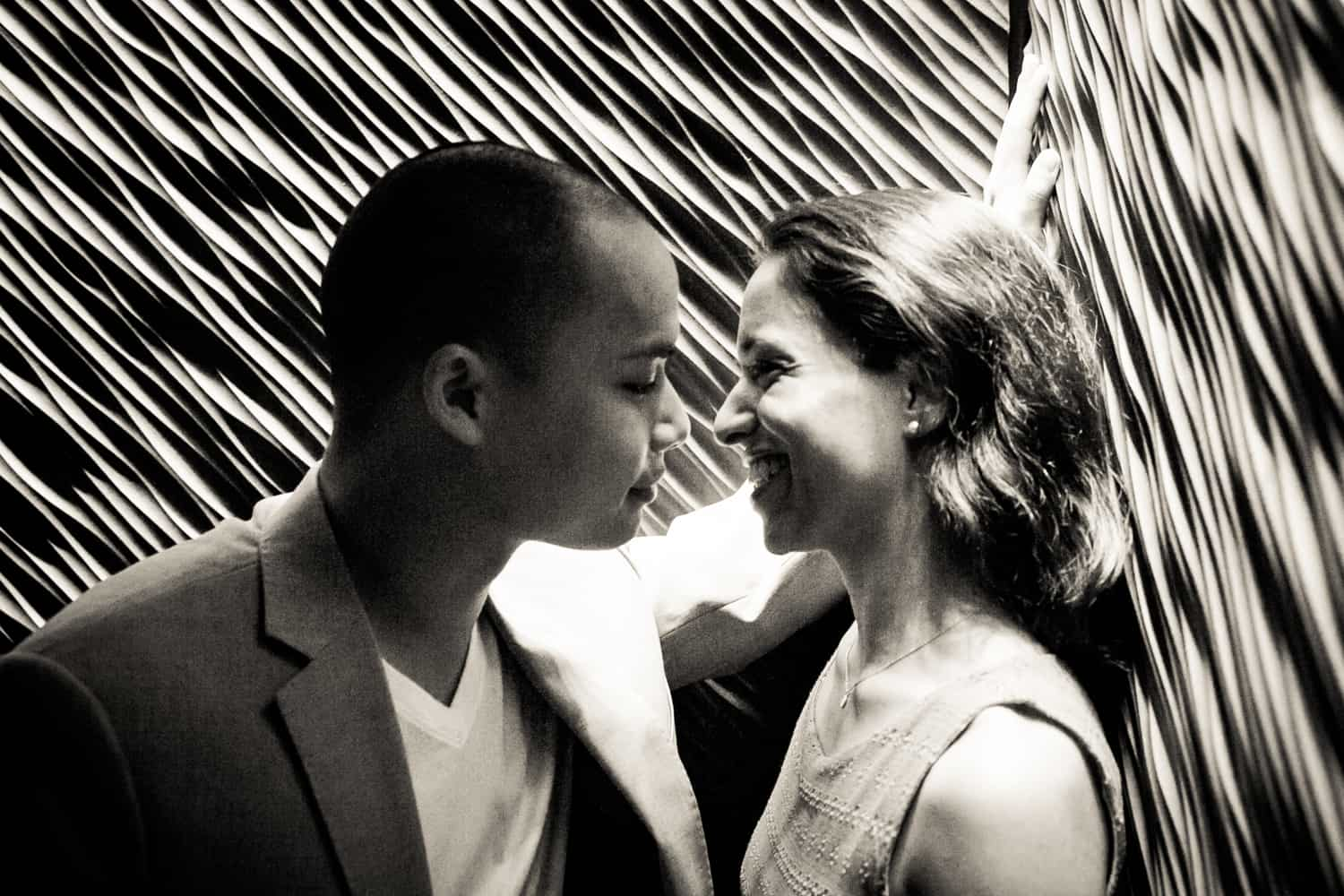 Black and white photo of couple in elevator during a Hudson Hotel engagement shoot