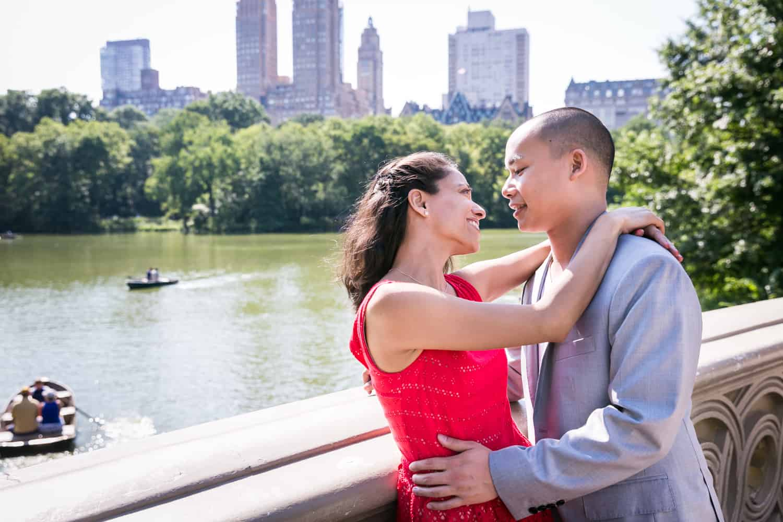 Couple hugging on Bow Bridge
