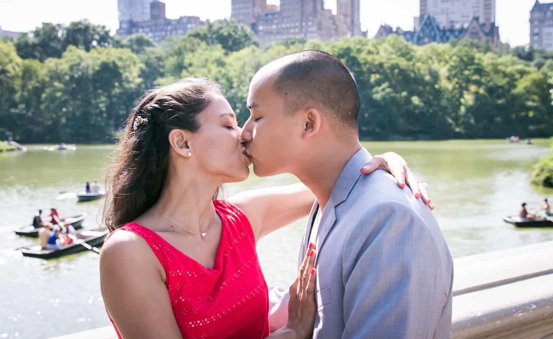 Couple kissing on Bow Bridge
