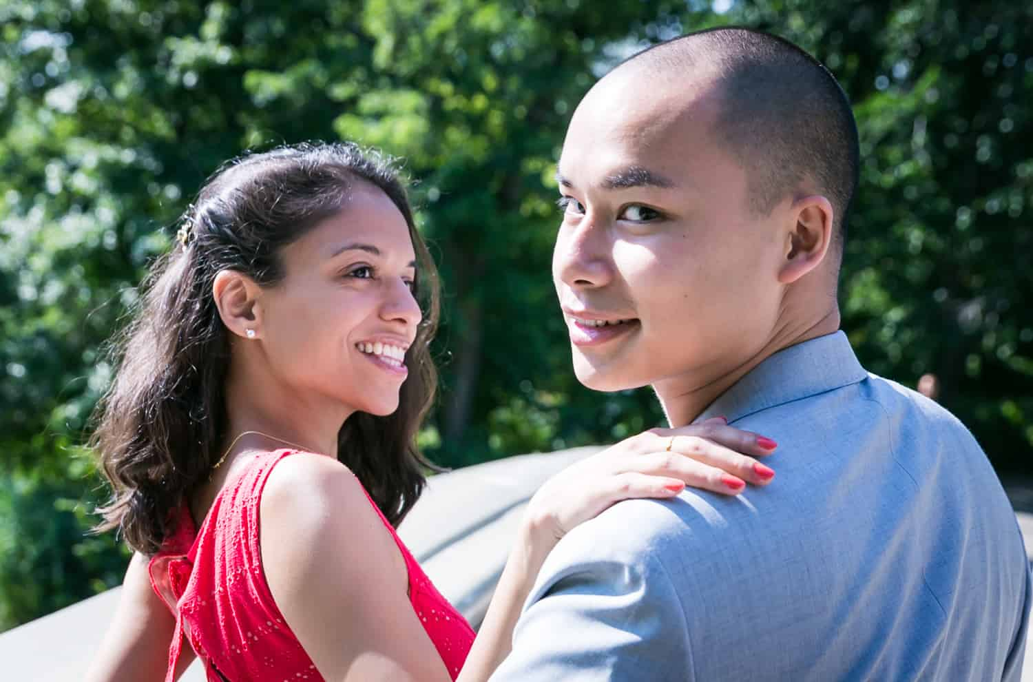 Couple walking in Central Park turning to look into camera