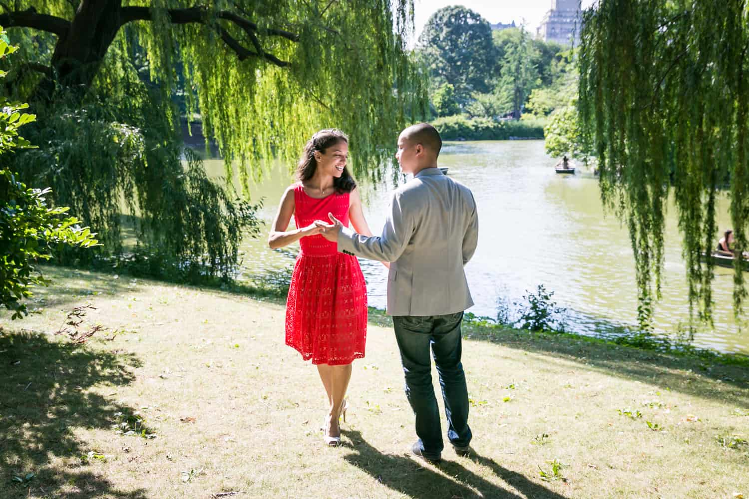 Couple dancing beside Central Park lake