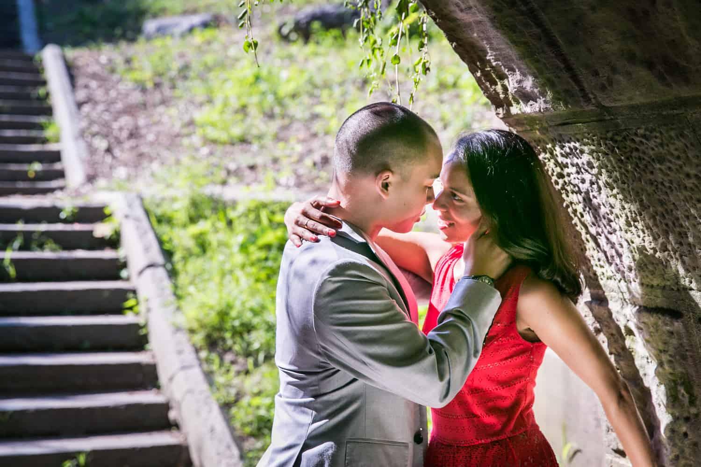Couple hugging under Trefoil Arch in Central Park