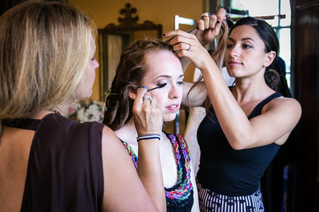 Bride having hair and makeup done at a Round Hill House wedding