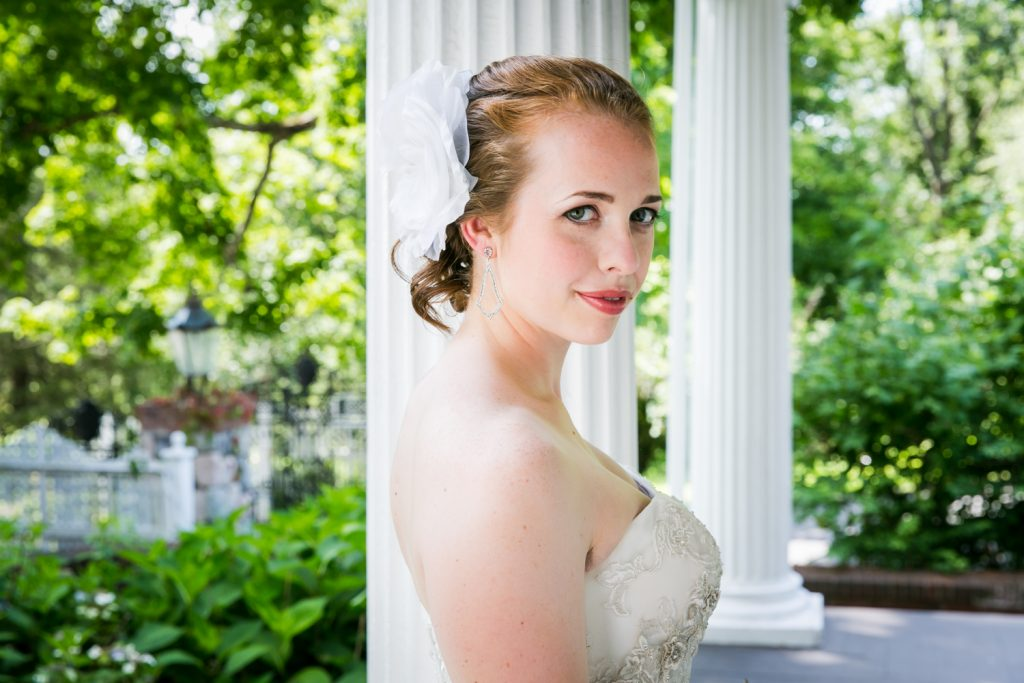 Bride looking over shoulder at a Round Hill House wedding