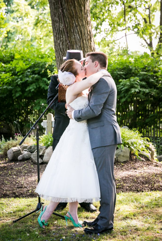 Bride and groom kissing after ceremony at a Round Hill House wedding