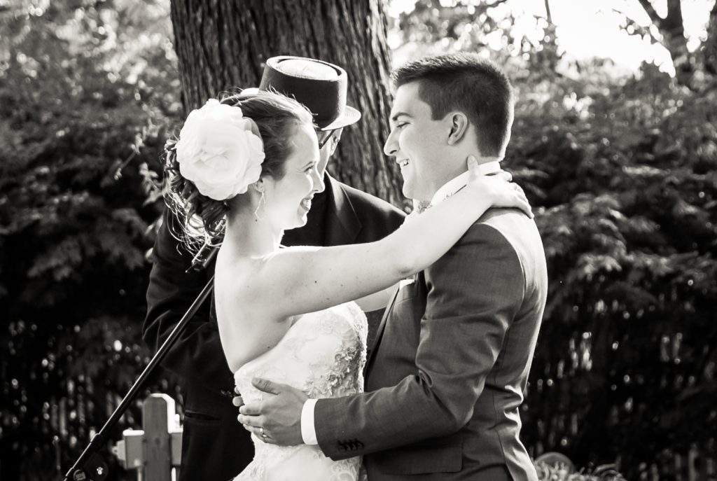 Black and white photo of bride and groom during Round HIll House ceremony