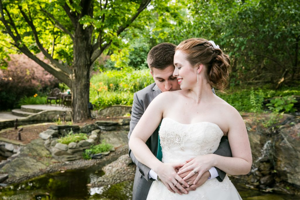 Bride and groom in garden at a Round Hill House wedding