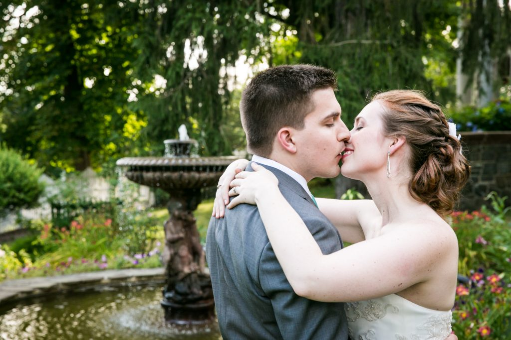 Bride and groom kissing in garden at a Round Hill House wedding