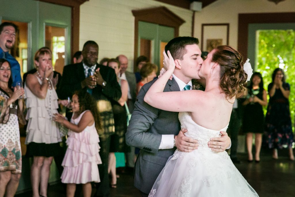 Bride and groom kissing on dance floor at a Round Hill House wedding