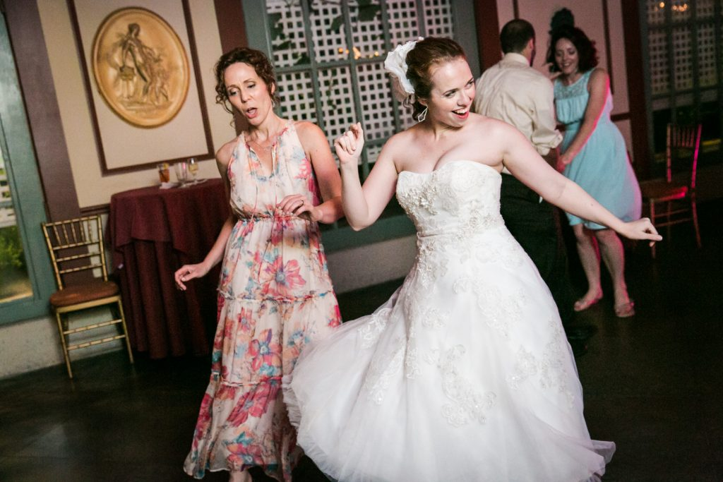 Bride and mother dancing during reception