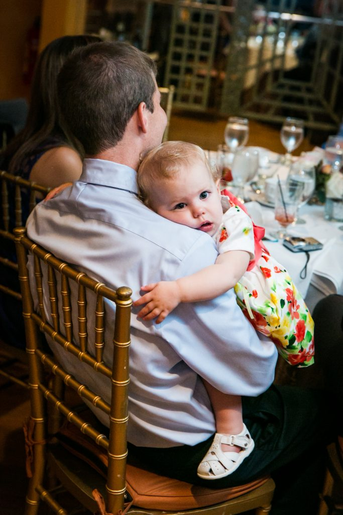 Baby laying on father's shoulder at a Round Hill House wedding