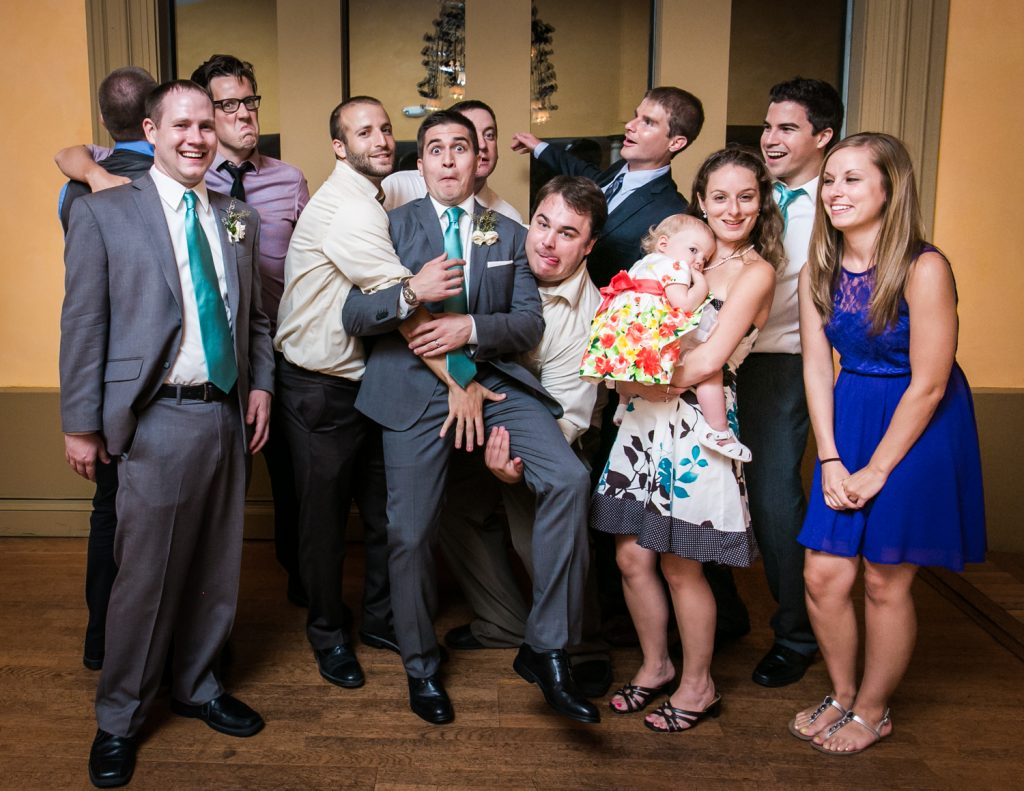 Bride and groom clowning around with friends at a Round Hill House wedding