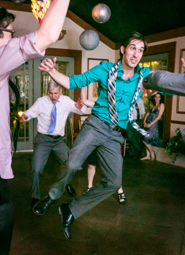Guest jumping in the air on the dance floor