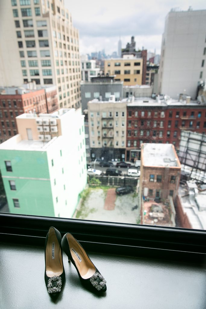 High heels in windowsill with NYC skyline in background