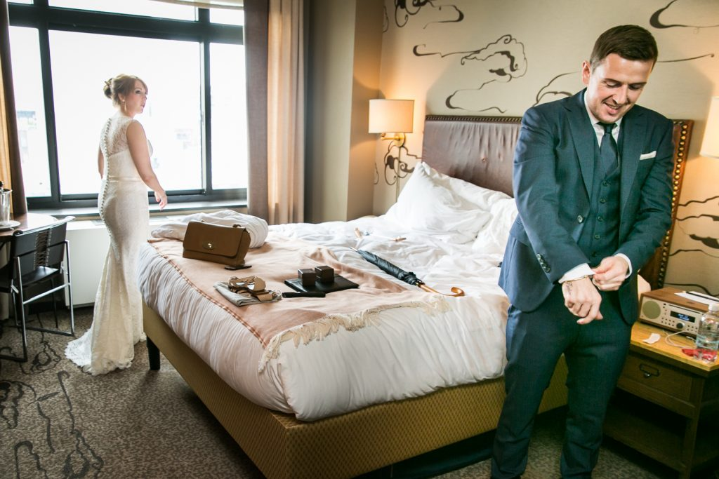 Bride and groom getting ready in hotel room