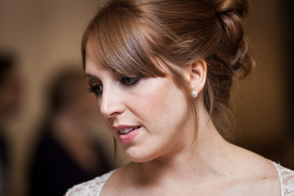 Close up of bride with red hair in updo