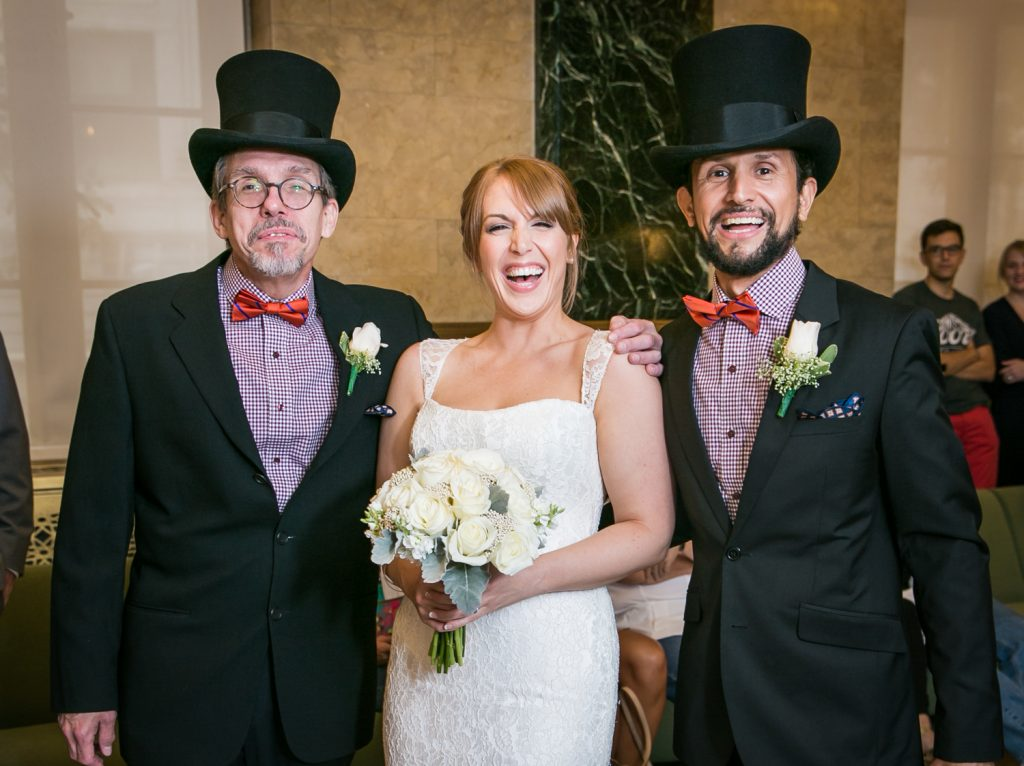 NYC City Hall wedding photos of bride with two men wearing top hats