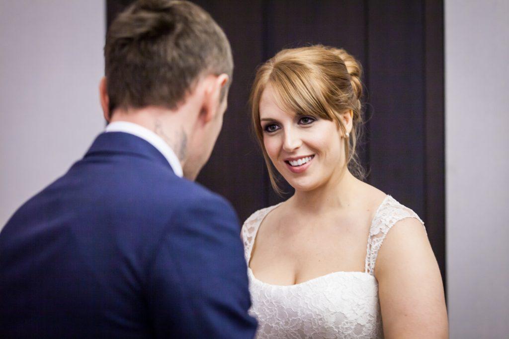 NYC City Hall wedding photos of bride looking at groom