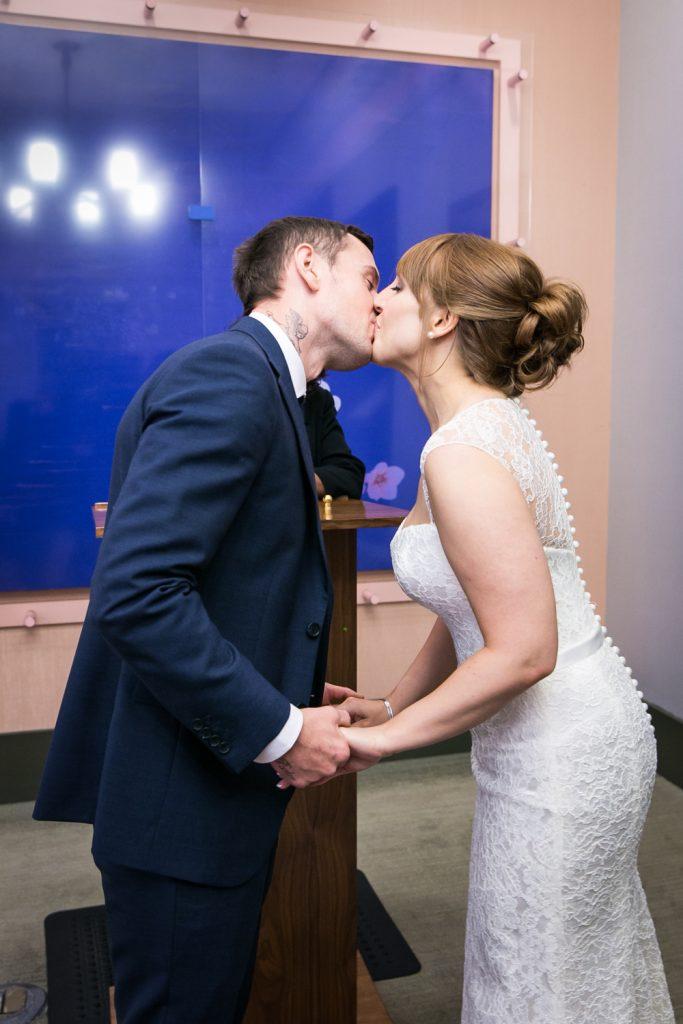 NYC City Hall wedding photos of bride and groom kissing