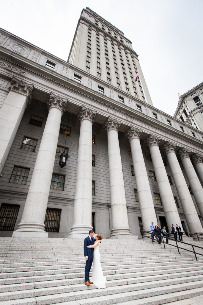 Bride and groom on steps of New York County Supreme Court building