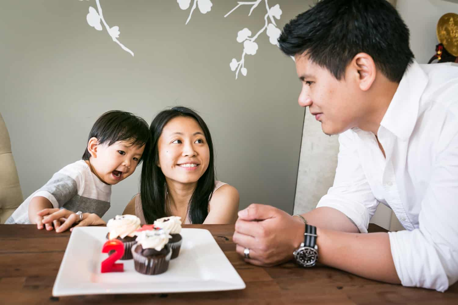 Manhattan family portrait of parents and child eating cupcakes
