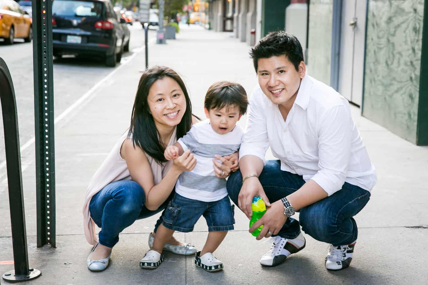 Portrait of Asian American family in the middle of sidewalk