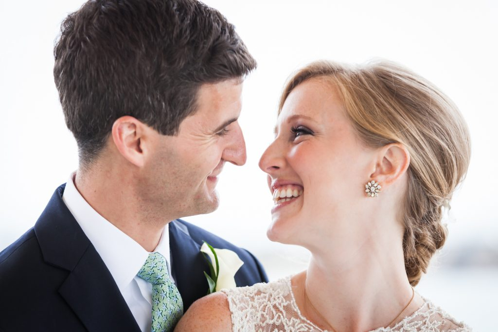 Bride and groom smiling at each other at an American Yacht Club wedding