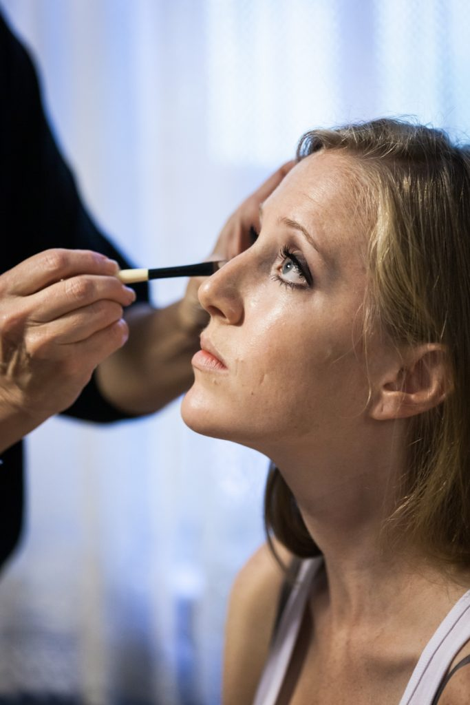 Bride having her eye makeup applied