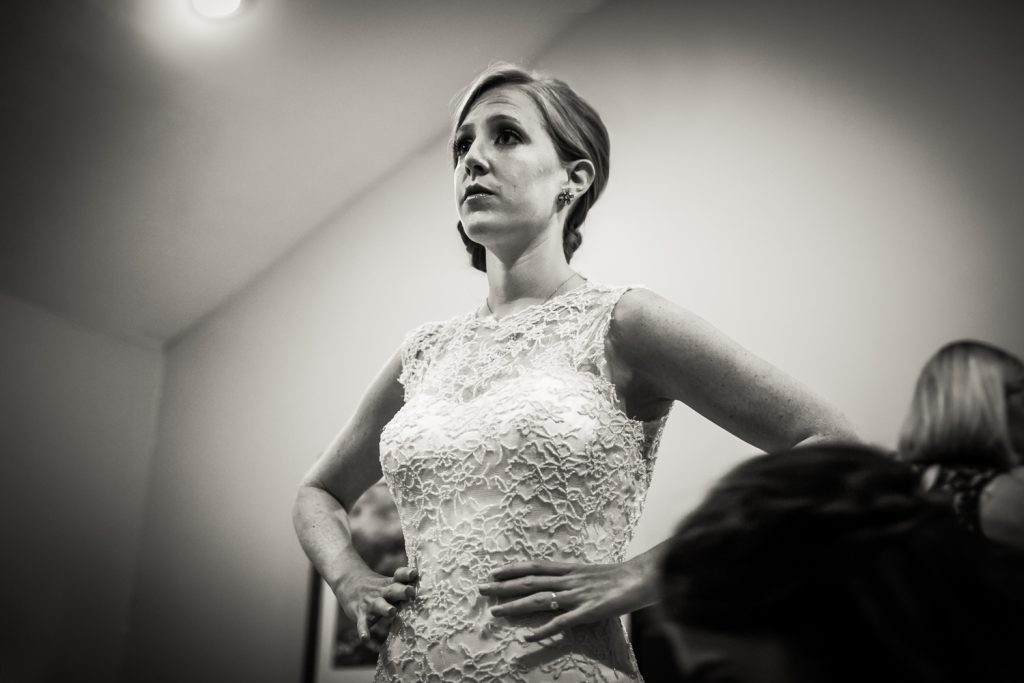 Black and white photo of bride with hands on hips