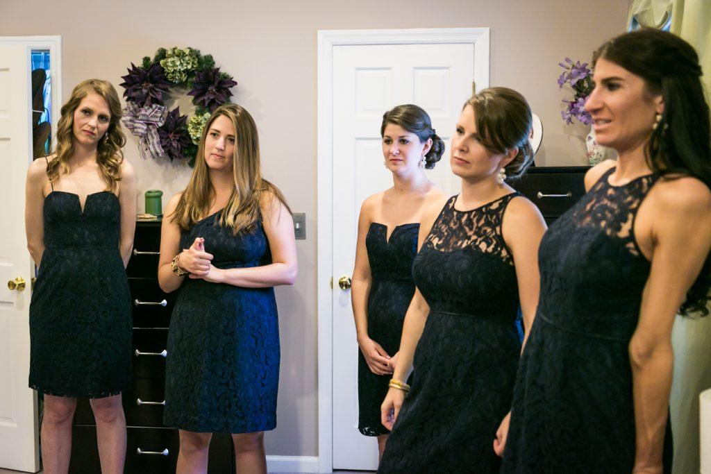 Bridesmaids in black dresses watching
