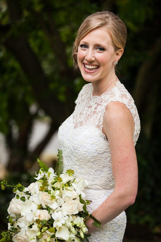 Portrait of smiling bride with flower bouquet